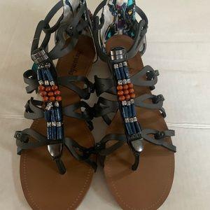 Buyamba bead gladiator sandal.
